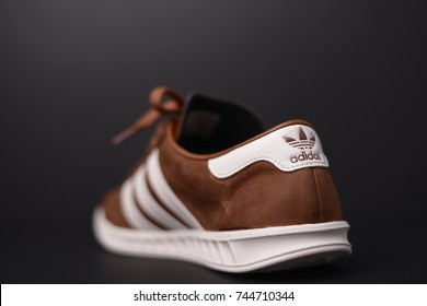 KUALA LUMPUR, MALAYSIA - October 28,2017: Adidas Originals Hamburg brown cream leather sneakers on black background - illustrative editorial