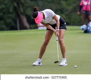 KUALA LUMPUR, MALAYSIA - OCTOBER 29, 2016: Michelle Wie of the USA putts at the green of the TPC Golf Course at the 2016 Sime Darby LPGA Malaysia golf tournament.