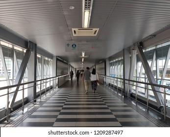 Kuala Lumpur, Malaysia. October 5, 2018.  Citizen walking along the 1.173km-long pedestrian bridge, KLCC - Bukit Bintang Walkway that connects Pavilion KL to Impiana KLCC Hotel and Convention Centre