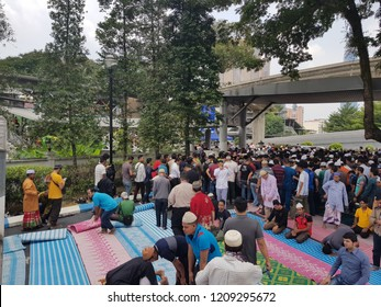 Kuala Lumpur, Malaysia. October 5, 2018. Muslim congregations spread out exiting the mosque after Friday prayer at Al-Bukhary Foundation Mosque, Pudu, Kuala Lumpur.