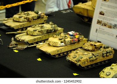 Miniature Toy Soldier with Tank Images, Stock Photos