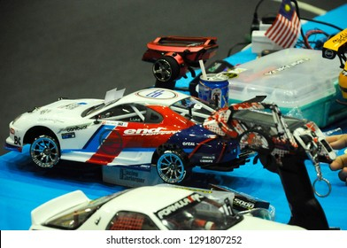 KUALA LUMPUR, MALAYSIA -OCTOBER 6, 2018: Remote control car's contestant preparing and servicing their remote control car on site. Ready for next coming race.