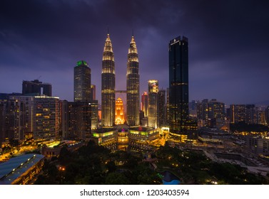 KUALA LUMPUR, MALAYSIA, OCTOBER 8 2018 : Dramatic clouds during blue hours at Petronas Twin Tower