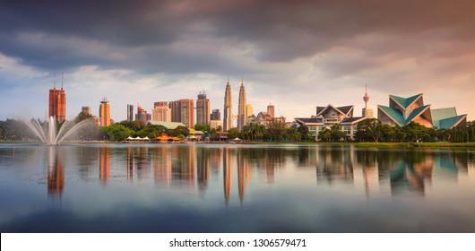 Kuala Lumpur, Malaysia. Panoramic cityscape image of Kuala Lumpur skyline during sunset.