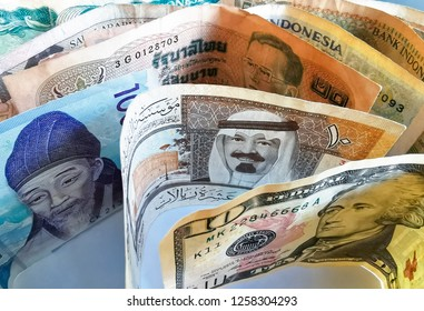 KUALA LUMPUR, MALAYSIA :Part of 10 dollar banknote, 50 ringgit Malaysian banknotes, Saudi Arabia banknotes, South Korean banknote of 1000 won with old banknotes from different country on Dec 14, 2018