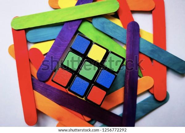 KUALA LUMPUR, MALAYSIA : Rubik's Cube with ice cream sticks on the white background on December 11, 2018