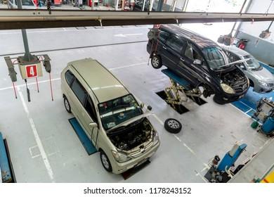 Kuala Lumpur, MALAYSIA - Sep 12, 2018: Car raised on car lift in autoservice at Toyota car service center at Selayang, Kuala Lumpur.