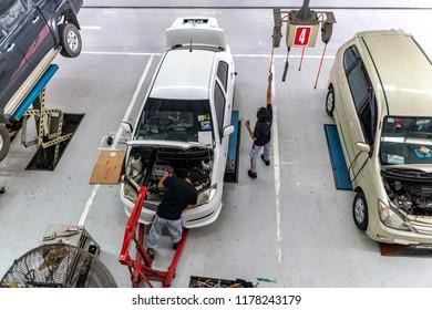 Kuala Lumpur, MALAYSIA - Sep 12, 2018: Serviceman checking engine in a car at garage. Toyota car service center at Selayang, Kuala Lumpur.