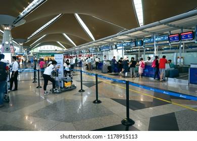 Kuala Lumpur, Malaysia - Sept 10, 2017. Passengers line up for check in at Kuala Lumpur International Airport (KLIA), Malaysia.