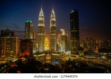 Kuala Lumpur, Malaysia – Sept 14 2018 : Petronas Twin Towers (fondly known as KLCC) and the surrounding buildings during sunset seen from the Skybar at Traders Hotel.