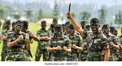 KUALA LUMPUR, MALAYSIA - SEPT. 30: Kasturi Battalion performs war dance at Convocation Festival at National Defense University Of Malaysia, Kuala Lumpur, Malaysia on September 30, 2011.