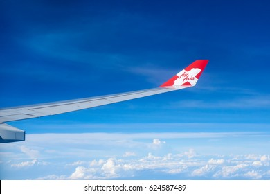 KUALA LUMPUR, MALAYSIA - SEPTEMBER 11, 2016: The winglet and wing of an AirAsia-X plane with its logo. Focus on the winglet. AirAsia has won Skytrax's 'World's Best Low-Cost Airline' for 7 years
