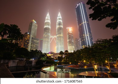 Kuala Lumpur, Malaysia -  September 12 2019: The Kuala Lumpur skyline at KLCC featuring the Petronas Twin Towers and water show in Malaysia