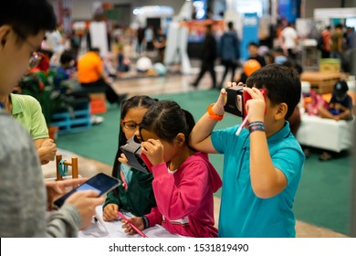 Kuala Lumpur, Malaysia - September 14, 2019 : Kids trying out the science & techology equipments at Malaysian Digital Fair in Malaysia International Trade and Exhibition Centre (Mitec).