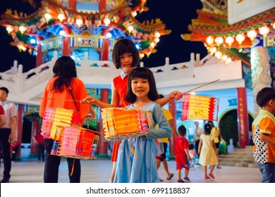 Kuala Lumpur, Malaysia - September 15, 2016:  Little girls pose with paper lanterns at Thean Hou Temple at the lantern parade during Mid-Autumn Festival on September 15, 2016, Kuala Lumpur, Malaysia.