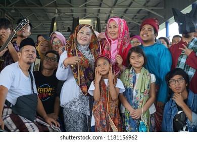 KUALA LUMPUR, MALAYSIA  - SEPTEMBER 16, 2018: Malaysian wearing Sarong to celebrate Malaysia Day.