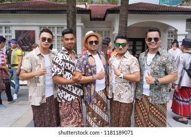 KUALA LUMPUR, MALAYSIA - SEPTEMBER 16, 2018: Models wearing sarong pose during Malaysia Day celebration at Malaysia Tourism Center