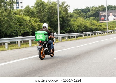 KUALA LUMPUR, MALAYSIA, September 17, 2019: Grabfood ordered online being delivered on motorbike by grab rider.  Grabfood is a fastest growing food delivery service in Asia.