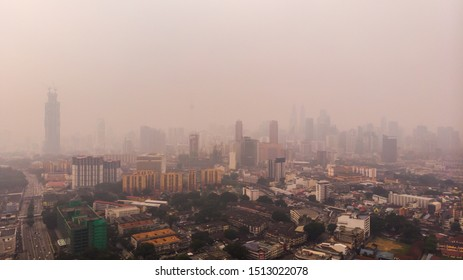 Kuala Lumpur, Malaysia : September 19 2019: Malaysia looks to clouds, as smoke haze shrouds Kuala Lumpur as the result of forest burning in Indonesia. Image contains noise due high ISO.