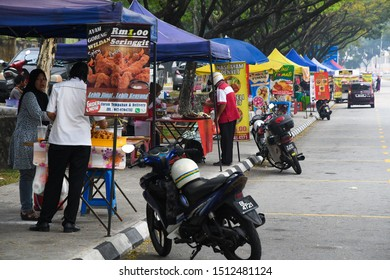 Kuala Lumpur, Malaysia - September 19,2019. Traders do business as usual during amidst smog on a polluted day in Cheras