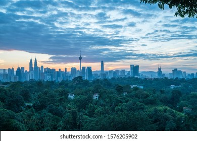 Kuala Lumpur, MALAYSIA - September 20, 2019: Majestic sunrise scene, misty morning landscape, Kuala Lumpur landmark over green lushes, silhouette of urban city, view from Bukit Changkat Tunku