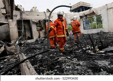 KUALA LUMPUR, MALAYSIA - SEPTEMBER 20, 2015: Malaysia firemen investigate the cause of fire after managed extinguish the huge fire which destroyed food court in Kuala Lumpur.
