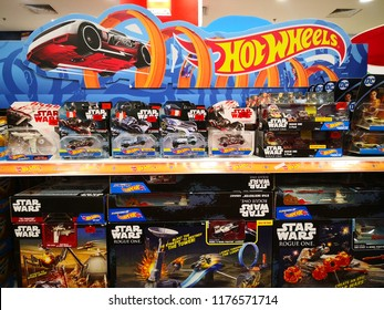 KUALA LUMPUR, MALAYSIA - SEPTEMBER 2018: Hotwheels toys logo on display at Toys 'r us. Hotwheels is a product of Mattel, with factories located in Penang, Malaysia and Thailand.