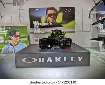 Kuala Lumpur, Malaysia - September 2019 : Oakley sunglasses display for sale at store. Oakley, Inc., based in Lake Forest, California, and a subsidiary of Italian company