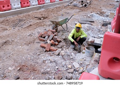 Kuala Lumpur, Malaysia - September 21, 2017 : A worker was seen doing his work at the construction site at side road.