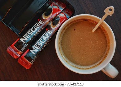 "KUALA LUMPUR, MALAYSIA - September 22, 2017. Sachet of instant Nescafe Regular .Nescafe is a brand of instant coffee made by Nestle.The name is a portmanteau of the words ""Nestle"" and ""cafe""."