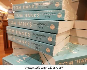 Kuala Lumpur, Malaysia. September 25, 2018. The books title Uncommon Type by Tom Hanks on display at Kinokuniya Bookstore, Suria Mall, KLCC