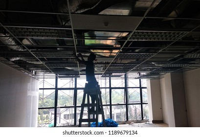 KUALA LUMPUR, MALAYSIA -SEPTEMBER 26, 2018: Suspended ceiling frame and board under construction at the construction site. Electrical and mechanical fitting installation work also on going.
