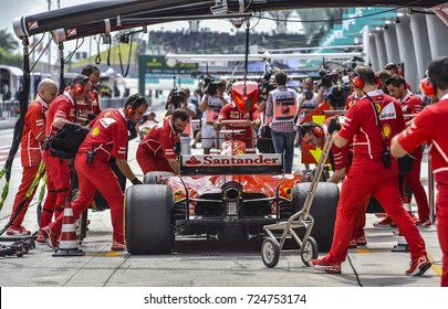 KUALA LUMPUR, MALAYSIA - SEPTEMBER 28, 2017 : Team mechanics work on Red Bull Racing car during Malaysia Formula One Grand Prix at Sepang Circuit.
