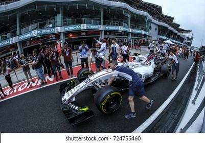KUALA LUMPUR, MALAYSIA - SEPTEMBER 28, 2017 : Team mechanics work on William Martini Racing Lance Stroll racer car during Malaysia Formula One Grand Prix at Sepang Circuit.