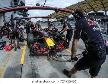 KUALA LUMPUR, MALAYSIA - SEPTEMBER 28, 2017 : Mechanics attend to Red Bull Racing driver Daniel Ricciardo car during Malaysia Formula One Grand Prix at Sepang Circuit.