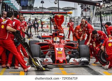 KUALA LUMPUR, MALAYSIA - SEPTEMBER 28, 2017 : Mechanics attend to Ferrari's Finnish driver Sebastian Vettel car during Malaysia Formula One Grand Prix at Sepang Circuit.