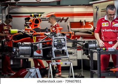 KUALA LUMPUR, MALAYSIA - SEPTEMBER 28, 2017 : Team mechanics work on Scuderia Ferrari Sebastian Vettel car at the garage during Malaysia Formula One Grand Prix at Sepang Circuit.