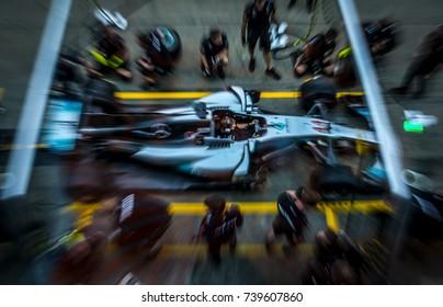 KUALA LUMPUR, MALAYSIA - SEPTEMBER 28, 2017 : Team mechanics work on Mercedes AMG racer Lewis Hamilton's car at the garage during Malaysia Formula One Grand Prix at Sepang Circuit.