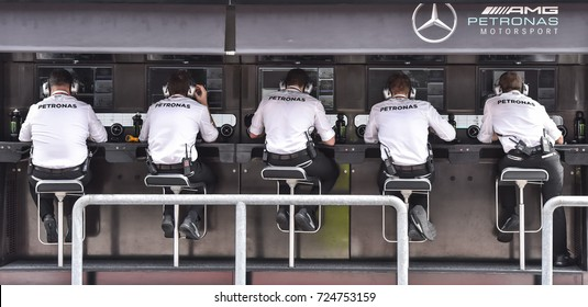 KUALA LUMPUR, MALAYSIA - SEPTEMBER 29, 2017 : Mercedes AMG Petronas Motorsport crew of the first practice session on a screen for the Malaysia Formula One Grand Prix at Sepang Circuit