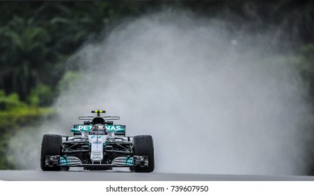 KUALA LUMPUR, MALAYSIA - SEPTEMBER 29, 2017 : Valtteri Bottas of Finland driving the Mercedes AMG Petronas F1 Team on track during practice for the Malaysia Formula One Grand Prix at Sepang Circuit.