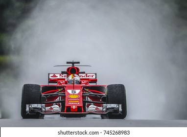 KUALA LUMPUR, MALAYSIA - SEPTEMBER 29, 2017 : Sebastian Vettel of Germany driving the (5) Scuderia Ferrari SF70H on track during practice for the Malaysia Formula One Grand Prix at Sepang Circuit.