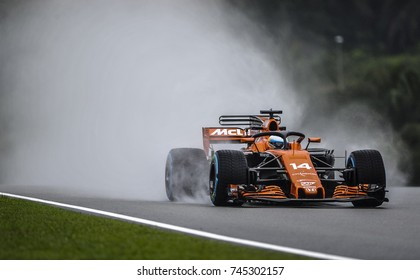 KUALA LUMPUR, MALAYSIA - SEPTEMBER 29, 2017 : Fernando Alonso of Spain driving the (14) McLaren Honda Formula 1 during practice for the Malaysia Formula One Grand Prix at Sepang Circuit.