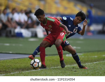 KUALA LUMPUR, MALAYSIA -SEPTEMBER  30, 2018 : Wail Sulaiman,left, of Oman in action during AFC U-16 Championship 2018 (Quarter Final) between Oman and Japan at National Stadium Bukit Jalil.