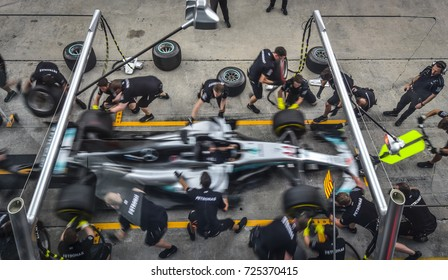 KUALA LUMPUR, MALAYSIA - SEPTEMBER 30, Mechanics of AMG Petronas F1 Team at the Pit Lane during Malaysia Formula One Grand Prix at Sepang Circuit