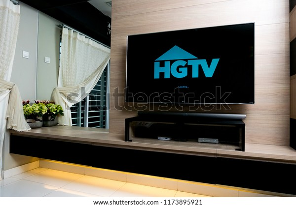 KUALA LUMPUR, MALAYSIA - SEPTEMBER 7TH, 2018 : Modern lifestyle with LG Android TV to stay connected & browsing media using favourite Apps. TV display HGTV app over dark background.