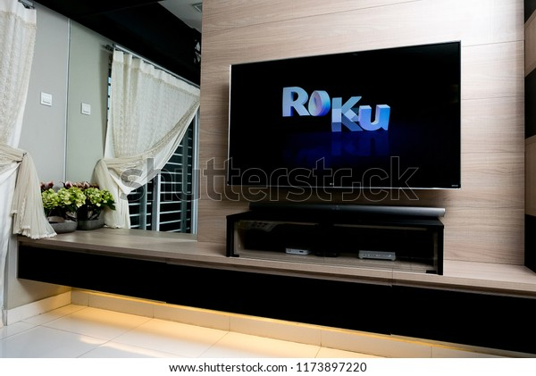 KUALA LUMPUR, MALAYSIA - SEPTEMBER 7TH, 2018 : Modern lifestyle with LG Android TV to stay connected & browsing media using favourite Apps. TV display Roku logo over black background.