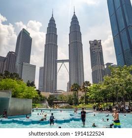 Kuala Lumpur, Malaysia - summer 2020 : Petronas Twin Towers with bridge, modern architecture and capital city panorama tourist destination