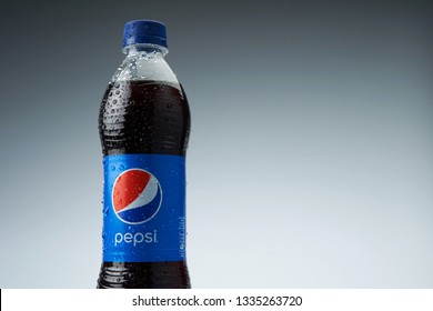 kuala lumpur malaysia,10th march 2019 pepsi bottle  drink with water drop on the blue background