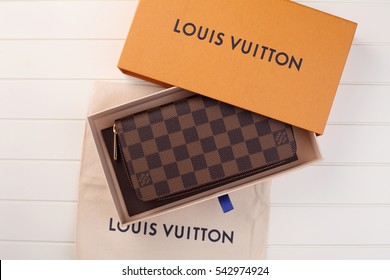 kuala lumpur, malaysia,19th Dec 2016,Louis Vuitton wallet on the white background ,Louis Vuitton is a designer fashion brand known for its leather goods