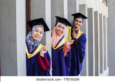 KUALA LUMPUR, MALAYSIA-20 DEC 2017: Three happy graduate with graduation gown and hat.